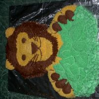 Lion This is completely made out of buttercream, the whiskers are spaghetti.