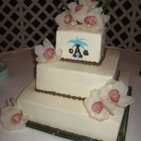 Img_0210.jpg iced in bc with fondant monogram, florist provided the bamboo at the base