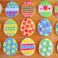 Easter Egg Cookies, Part 2 Easter egg sugar cookies decorated with MMF and shimmer dust. They are 4 1/2 inch high. Thanks for looking!