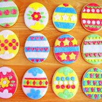 Easter Egg Cookies Part 1 Easter egg sugar cookies decorated with MMF and shimmer dust. They are 4 1/2 inch high. Thanks for looking!