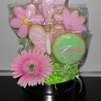 Flower Cookie Bouquet This is actually a graduation gift and her favorite color is pink. So I thought I would do something different since the school colors are...