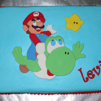 Super Mario Galaxy 2 Buttercream with fondant decorations.