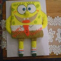 Spongebob I made this cake for a co-worker. The arms, legs, feet, and nose are made out of swiss rolls and entire cake is iced with bc.
