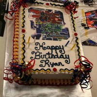 Transformer Cake Both of my boys had Transformer parties. Yellow cake with edible image.