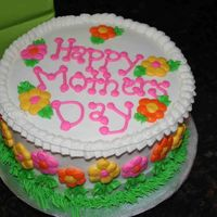 Mother's Day Chocolate cake, caramel pecan filling, buttercream dream icing.