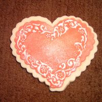 Valentine Day Heart Cookie   I used fondant, royal icing, and luster dust.