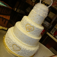 "50Th Wedding Anniversary 4 tiers: 6"", 9"", 12"", 15"" WASC/buttercream. Decorations: Store-bought topper, gold sugar pearls, gold Luster Dust."