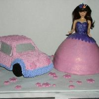 Barbie & Car Car is chocolate cake, buttercream, cookie tires. Barbie is white cake, fondant dress. Fondant flowers. Thanks for looking.