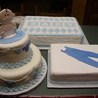 Baby Shower Cakes  Cakes are White Almond Sour Cream Wedding Cake. Round Cake is covered with MMF and MMF decorations. My version of Wilton's Baby...