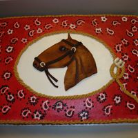 Horse Cake   Chocolate sheet cake with BC, hand piped bandana print, fondant horse head.