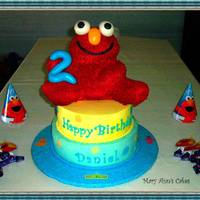 "Elmo RCT Elmo covered with RI. Fondant eyes, nose, mouth and ""2"".Cake is chocolate with bavarian creme filling and IMBC. Tappit..."