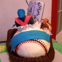 "Softball Birthday Personalized to recipient - softball cake in modeling chocolate glove; gum paste pipe with spaghetti ""leak"" and gel water; gum..."