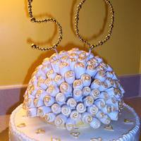 50Th Anniversary Hazelnut cake with IMBC icing. Royal icing hearts, gum paste roses and beaded topper.