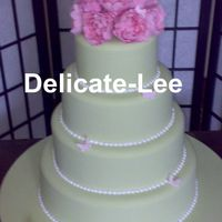 Peony Green This cake was for my first comp! The theme was a garden wedding. Icing pink peonies and butterflies.