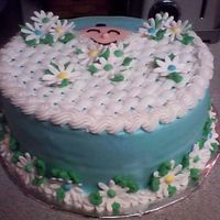 Baby In Blanket   All BC with royal icing daisies. Made for a baby boy shower.