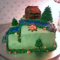 Outdoor Cabin   This was a cake I made for my dad's birthday. All BC with a pretzel cabin.