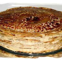 Crepe Creme Legere Cake   These are scratch crepes layered with a homemade Creme Legere and carmelized top to make this delicious texured cake.