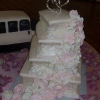My First Wedding Cake This is my first wedding cake! all white and yellow cake with buttercream covered in MMF. I carved the sides of the cake in to give it a...