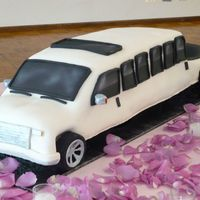 F350 Streched Limo Cherry Chip cake with chocolate mousse filling covered in MMF. The couple wanted the limo they would be in on the wedding day for their...