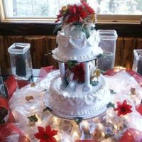 My First Wedding Cake   Christmas Poinsetta flowers and clear lights around the table.