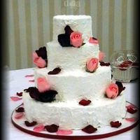 Stacked Round Four Layers The bride wanted the icing to look like stucco. Real roses were used to accent. This was my second wedding cake.