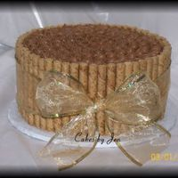 Piroulette Chocolate Cake Triple chocolate cake, chocolate mousse filling, mocha icing, and capaccino pirouline on the outside. I made this for my husband's co-...