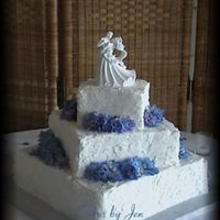 "Square ""stucco"" Stacked 6"" 10"" 14"" square stacked offset wedding cake. The bride wanted the stucco look. The flowers are delphiniums, which were..."