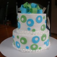 Blue And Green Polkadot Cake  this was for my friends 17th birthday!!!! she loved it. its 2 tier vanilla cake. with buttercream frosting. the bow and dots are make of...