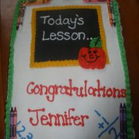 Teacher Grad Cake vanilla cake with buttercream frosting. the blackboard is fondant. got a inspiration from another cake on here. thanks for looking.