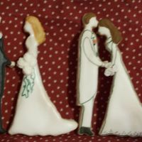 Bride And Groom Cookies One bride got bent as she baked but I like how it looks like he is kissing her head