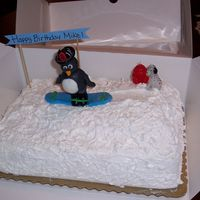 Snowboarding Penguin Cake I made this cake for my brother's birthday. He was going snowboarding the next week and since I had about 2 hours to bake and decorate...