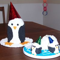 Penguin Birthday Cake The igloo is made out of ice cream and the little penguin are cake!