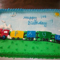 Paul's 1St Birthday This cake was a half-sheet cake that was half yellow and half chocolate. I frosted it with Extra Special Buttercream and the train and sun...