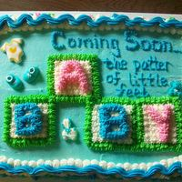 "Pitter Patter Of Feet This is a 9 x 13"" yellow cake with Extra Special Buttercream Frosting. This was based on a Wilton Yearbook design. Decorations are..."