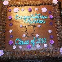 "Congratulations Rebekah This was a 2-layer 16"" Deep Dark Chocolate Cake with Chocolate Buttercream. The flowers were store bought sugar flowers. Unfortunately..."
