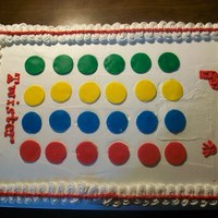 Twister This was a half sheet cake with Bettercreme Frosting and Fondant Cutouts. The cake was half yellow tih Bettercreme Filling and half...