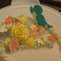 Course 2 Close up of royal icing flowers and color flow bird.