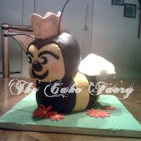 Lauren  A cake for my brother's BBF birthday. They call her Queen Bee so he wanted a cake of a Bee w/a crown.White cake, covered in fondant, &...