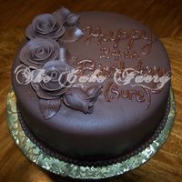Chocolate Birthday   Chocolate cake w/chocolate fudge filling. Covered in chocolate fondant