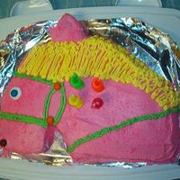 Horse My daughter wanted a pink horse for her birthday. She didn't like any of the horse cake pans, so I cut this one out of 11x13 pan.