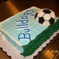 End Off Season Soccer Cake   11*15 inch pan with half of the 3d sports ball pan ,yellow butter cake with buttercream frosting..