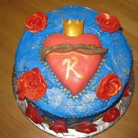 Karena's Sacred Heart frosted in Buttercream, fondant branches with thorns, heart is rtk covered in fondant...we used gold dust luster to accent leaves, trim on...