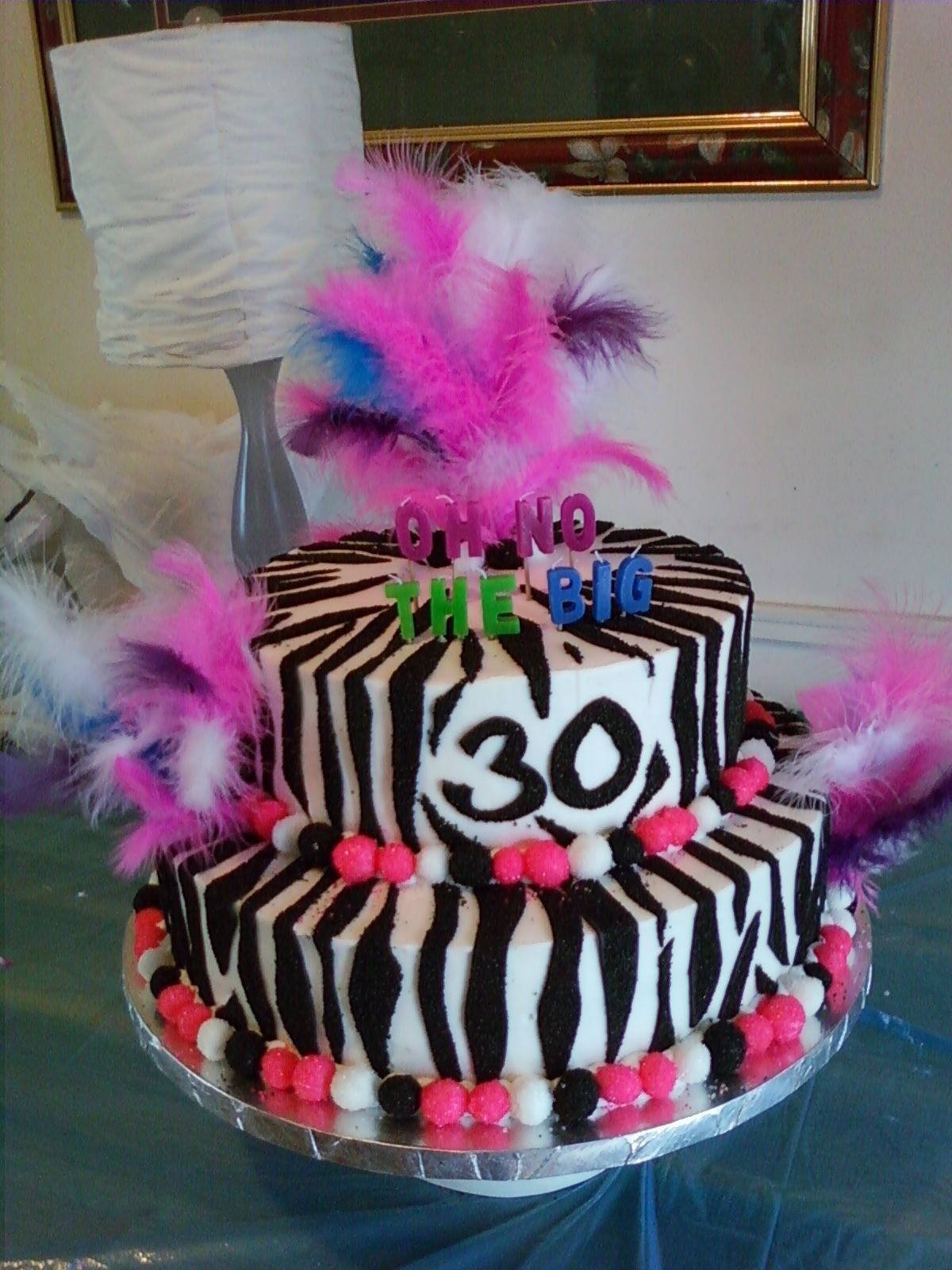 Zebra 30Th Birthday Cake Lemon cake with raspberry filling...chocolate cake with oreo cookie dessert filling...zebra strips are fondant dipped in black sanding...