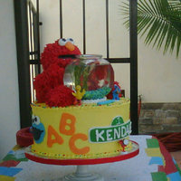Chile's First Birthday Omg!! what a cake..this was super fun to make!! Yellow cake w/chocolate mousse filling...elmo was yellow cake as well..arms and legs where...