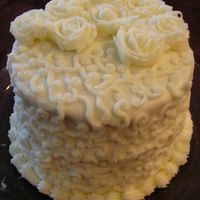 White Cake  Just a practice cake I did. It was so hot in my house the buttercream was not standing as well as needed, oh well. It turned out ok, this...