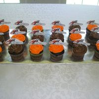 Chainsaw Cupcakes  I did these for a party for my dads chainsaw site. Its a lot like cake central just for chainsaws :). They had a meet and greet type thing...
