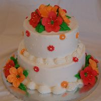 Petunia Cake This is my favorite cake I have done so far. They just told me they like red and orange for the colors so I got to pick the rest. Iced in...