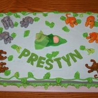 Jungle Shower Cake Everything is buttercream except for the baby, leaves covering him and the letters are fondant