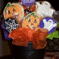Halloween Bouquet NINE flippin cookies in a 50 cent plastic cauldron. Had to hot glue the tallest middle one in the hole. Used lollipop sticks intead of...