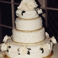 Daughter's Wedding Cake  Thought I'd post my daughter's wedding cake made Jan 2001. Hubby dropped the top tier when his T shirt sleeve caught the door...